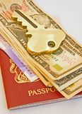 Key to travel; passport, money and a hotel. Royalty Free Stock Photo