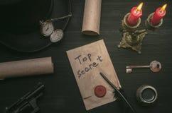The key to unraveling. The clue. Top secret message document. Forbidden information. Top secret message document. Forbidden information. Detective agent desk Stock Photo