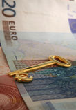 Key to wealth 1. A gold euro key resting on a pile of euro banknotes Royalty Free Stock Image