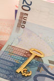 Key to wealth 2. A gold euro key resting on a pile of euro banknotes Royalty Free Stock Photography