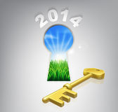 Key to your future 2014 concept. Key to the future 2014 concept of a keyhole with a new dawn over verdant landscape and gold key royalty free illustration