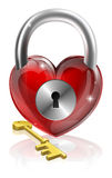 Key to your heart. Conceptual illustration. A heart shaped padlock with a brass key Stock Photography