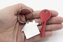 Key to your own new apartment. Held in open hand Stock Photos
