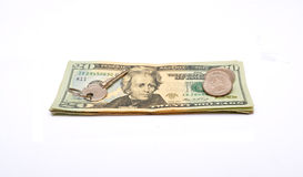 Key on top of dollar bills and coins Stock Image