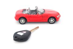 Key and toy red car Stock Photos