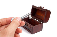 Key and treasure chest Stock Photo