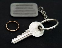 Key with trinket. On a black background Royalty Free Stock Images