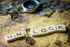 Key Unlock concept for treasure on vintage map Stock Photography