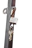 Key and Unlocked open padlock Stock Photo