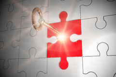 Key unlocking jigsaw Royalty Free Stock Photos