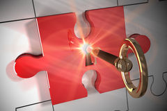 Key unlocking jigsaw Royalty Free Stock Image