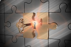 Key unlocking jigsaw Royalty Free Stock Images