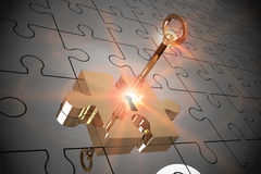 Key unlocking jigsaw Stock Photo