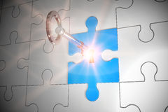 Key unlocking jigsaw Stock Photography