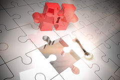 Key unlocking jigsaw Stock Images