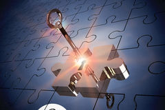 Key unlocking jigsaw Stock Photos