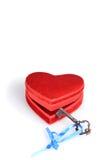 Key unlocking red heart. On white Royalty Free Stock Image