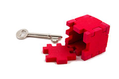 Key unlocks puzzle Royalty Free Stock Image