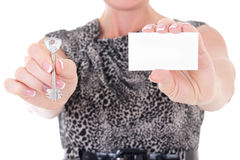 Key and visiting card in female hands Stock Images
