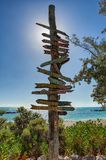 Key West beach distance signs stock image