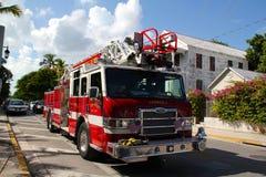 Key West Firetruck som tillbaka kör till brigadcentralen Arkivbilder