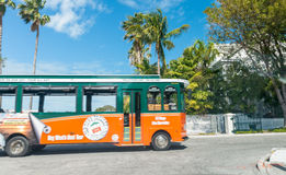 KEY WEST, FL - FEBRUARY 21, 2016: Old trolley moving fast. Key W. Est is a famous attraction in Florida Stock Image