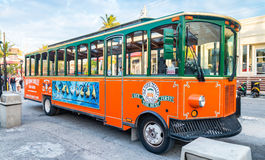 KEY WEST, FL - JANUARY 2016: A Old Town Trolley Car awaits passe. Ngers in Key West. The Trolley is a popular attraction that takes tourists on a narrated tour Stock Photos