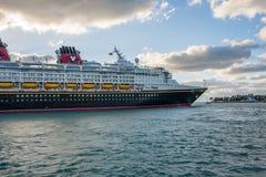 Walt Disney Cruise Ship. Key West, Florida: December 10, 2017: Walt Disney Cruise line ship departing in Key West, Florida. Walt Disney Company operates four Royalty Free Stock Photo