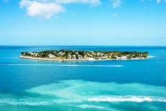 Key West Island. Isolated island off the coast of Key West surrounded by blue ocean waters and sport boats Stock Images