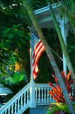 Key West Porch. Front porch exterior architecture of a building in Key West, Florida.  American flag is hanging from porch support post Royalty Free Stock Image