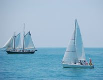 Key West sailing. A daytripping schooner and a small sloop share the waters near Key West Florida stock photo