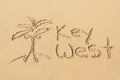 Key West in the Sand. A picture of a palm tree and the word Key West drawn in the sand Royalty Free Stock Photography