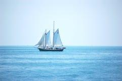 Key West Schooner. A gaff rigged schooner sails near key west florida royalty free stock image