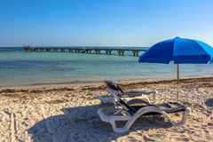 Key West summer holidays. Deck chairs and beach umbrellas in Higgs Beach, Key West, Florida, Unites States. Summer holidays, relaxing and summertime concept Stock Photo