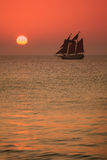 Key West Sunset. A sail boat in Key West as the sun sets Stock Photos