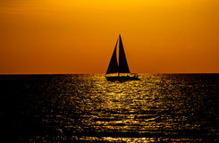 Key West Sunset with Sailboat Silhouette. Key West sunset taken from the famous Mallory Square in Key West, Florida, United States Royalty Free Stock Images