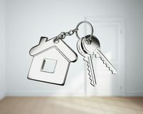 Key and  white rooms. Key with keychain on white rooms Royalty Free Stock Photos