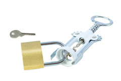 Key and a wine bottle opener locked to a padlock Stock Images