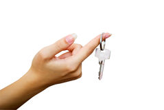Key in woman hand - isolated. Woman hand is showing key. Isolated on white Stock Photo