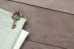 Key on wood textured background Royalty Free Stock Photos