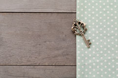 Key on wood textured background. Dot textile texture, key on wood textured background Royalty Free Stock Photography