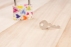 Key on wood , valentines concept. S stock photos
