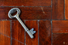 Key on wooden floor Stock Images