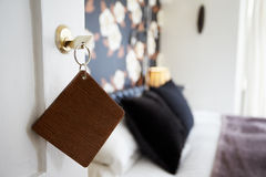Key And Wooden Fob In Door Of Hotel Bedroom Royalty Free Stock Photos