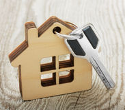 Key with wooden house Royalty Free Stock Images