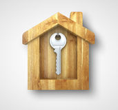Key in wooden house. Key hanging in a wooden house Stock Photography