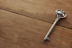 A key on wooden table Stock Images