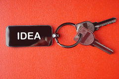 Key with word on red background, Royalty Free Stock Photography