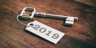 Key with year 2019 tag isolated on wooden background. 3d illustration Stock Photography