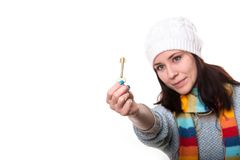 The key is in your hands. Beautiful girl in a knitted cap holds Royalty Free Stock Image